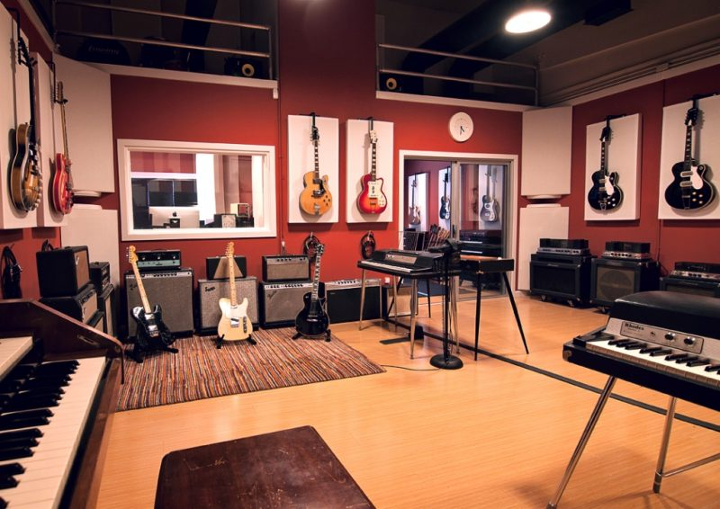 Lost Ark Studio Acoustics using GIK Acoustics acoustic panels and bass traps in corners and ingenious recording studio design ideas of hanging guitars in front of panels