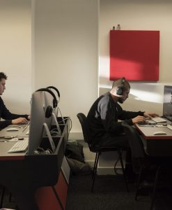 Abbey Road Institute's classroom walls feature GIK Acoustics red square 242 Acoustic Panels as students work