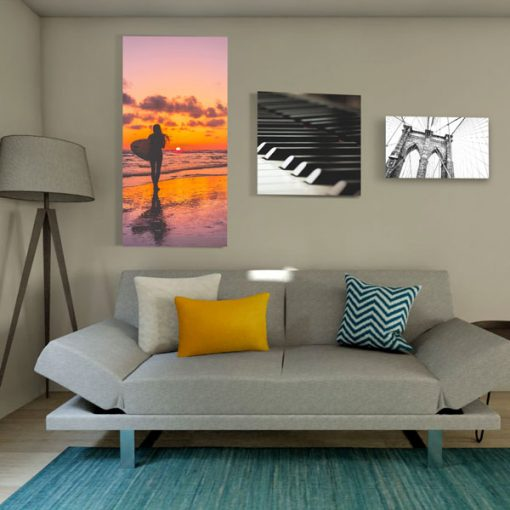 Acoustic Art Panels with multiple sizes above couch with lamp